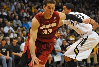 Jan 24, 2013; Boulder, CO, USA; Stanford Cardinal forward Dwight Powell (33) drives past Colorado Buffaloes forward Andre Roberson (21) in the second half of the game at the Coors Events Center. The Buffaloes defeated the Cardinal 75-54. Mandatory Credit: Ron Chenoy-USA TODAY Sports