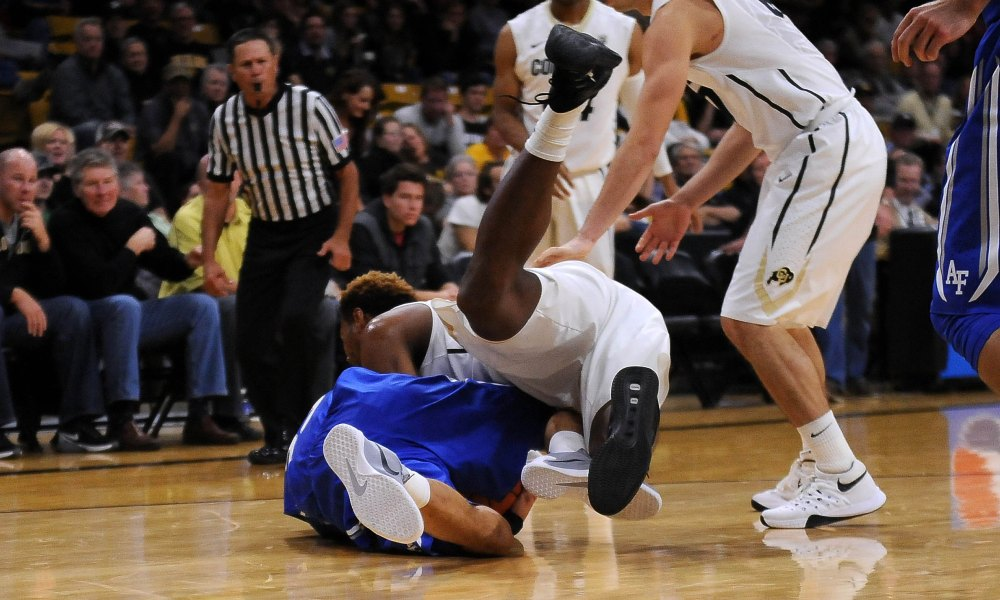 Nov 25, 2015; Boulder, CO, USA; Colorado Buffaloes forward Tory Miller (14) is called for a technical foul and ejected for biting the right shoulder of Air Force Falcons forward Hayden Graham (35) on this play in the second half at the Coors Events Center. The Buffaloes defeated the Falcons 81-70. Mandatory Credit: Ron Chenoy-USA TODAY Sports